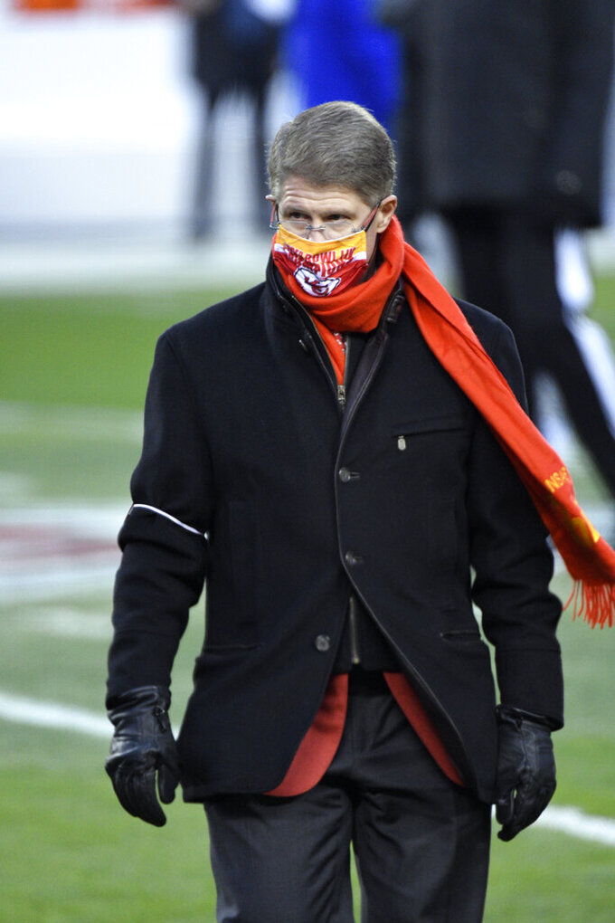 Kansas City Chiefs owner Clark Hunt walks on the field before the AFC championship NFL football game against the Buffalo Bills, Sunday, Jan. 24, 2021, in Kansas City, Mo. (AP Photo/Reed Hoffmann)