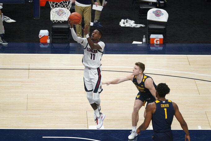 Gonzaga's Joel Ayayi (11) shoots as West Virginia's Sean McNeil (22) watches during the second half of an NCAA college basketball game Wednesday, Dec. 2, 2020, in Indianapolis. (AP Photo/Darron Cummings)