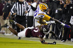 Texas A&M defensive back Jaylon Jones (17) cuts out the legs of LSU wide receiver Jaray Jenkins (10) during the first half of an NCAA college football game, Saturday, Nov. 28, 2020. in College Station, Texas. (AP Photo/Sam Craft)