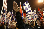 In this is a Saturday, Feb. 1, 2014 file photo of a supporter of Greece's extreme right party Golden Dawn as he raises his hand in a Nazi-style salute during a rally in Athens. Golden Dawn, the far-right, anti-immigrant party that had shocked Greek politics by evolving from a marginal, violent neo-Nazi group into Greece's third-largest party during the country's economic crisis, was knocked out of Parliament in Sunday's national election. (AP Photo/Yannis Kolesidis, file)