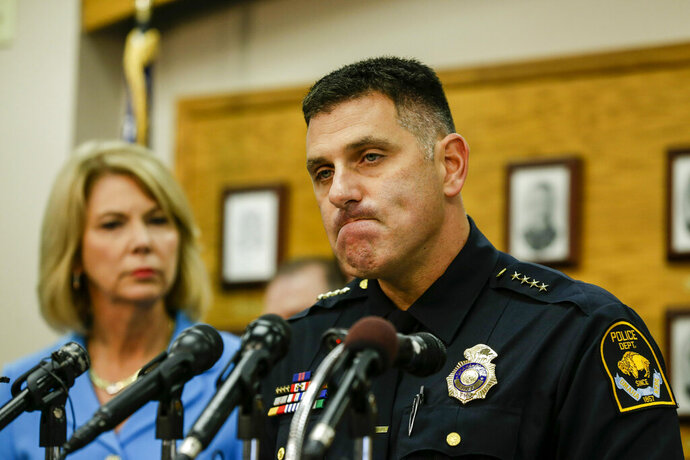 FILE - In this Aug. 27, 2014, file photo, Omaha Police Chief Todd Schmaderer pauses during a news conference at police headquarters in Omaha, Neb., with Omaha Mayor Jean Stothert, left. Bryce Dion, a sound technician with the