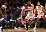 United States' Khris Middleton, second left, goes around the Canadian defenseduring their exhibition basketball game in Sydney, Australia, Monday, Aug. 26, 2019. (AP Photo/Rick Rycroft)