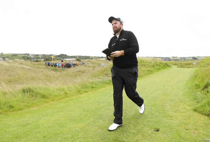 Ireland's Shane Lowry walks to the 17th hole during the first round of the British Open Golf Championships at Royal Portrush in Northern Ireland, Thursday, July 18, 2019.(AP Photo/Jon Super)