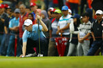 Matt Fitzpatrick of United Kingdom lines up a putt on the 9th hole during the foursome matches of the 2018 EurAsia Cup golf tournament at Glenmarie Golf & Country Club in Shah Alam, Malaysia, Saturday, Jan. 13, 2018. (AP Photo/Sadiq Asyraf)