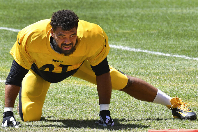 FILE - Pittsburgh Steelers Cam Heyward stretches during practice at Heinz Field in Pittsburgh, in this Monday, Aug. 17, 2020, file photo. Heyward was among the majority of Steelers who participated in the first day of organized team activities on Tuesday, May 25, 2021, a month after saying they would sit out due to concerns over health and safety protocols.(Peter Diana/Pittsburgh Post-Gazette via AP, File)