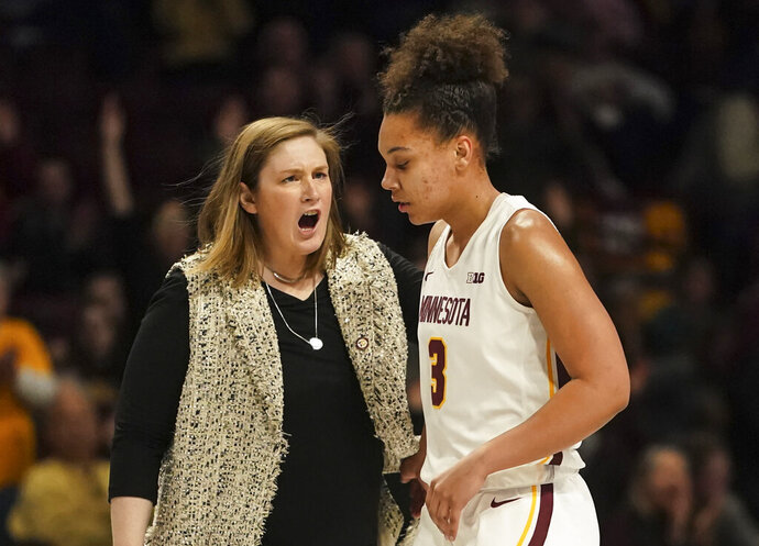 """In this Dec. 31, 2019, photo, Minnesota coach Lindsay Whalen cheers after guard Destiny Pitts hit a 3-pointer during the second half against Ohio State in an NCAA college basketball game in Minneapolis. Pitts said Thursday, jan. 16, she is transferring after the Gophers suspended her for unspecified """"conduct unbecoming a member of the team."""" (Renee Jones Schneider/Star Tribune via AP)"""
