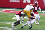 Minnesota wide receiver Chris Autman-Bell (7) is tackled by Nebraska linebacker JoJo Domann, right, and cornerback Cam Taylor-Britt, left, during the first half of an NCAA college football game in Lincoln, Neb., Saturday, Dec. 12, 2020. (AP Photo/Nati Harnik)
