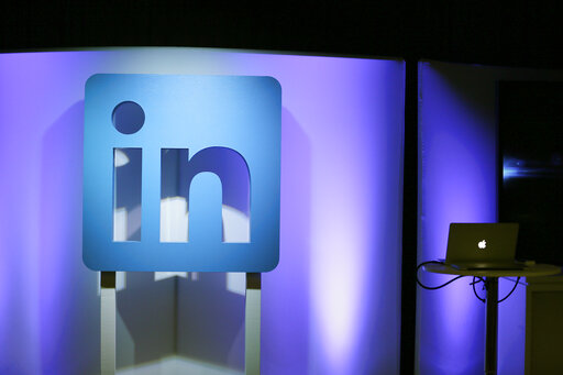 """FILE - In this Thursday, Sept. 22, 2016, file photo, the LinkedIn logo is displayed during a product announcement in San Francisco.  Microsoft says it is shutting down its LinkedIn service in China later this year following tighter government censorship rules. The company said in a blog post Thursday, Oct. 14, 2021,  it has faced """"a significantly more challenging operating environment and greater compliance requirements in China.""""  (AP Photo/Eric Risberg, File)"""