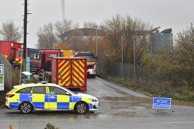 """Emergency services attend to a large explosion at a warehouse in Bristol, England, Thursday Dec. 3, 2020. A local British emergency services department says there have been """"multiple casualties"""" following a large explosion at a warehouse near the southwest England city of Bristol. (Ben Birchall/PA via AP)"""