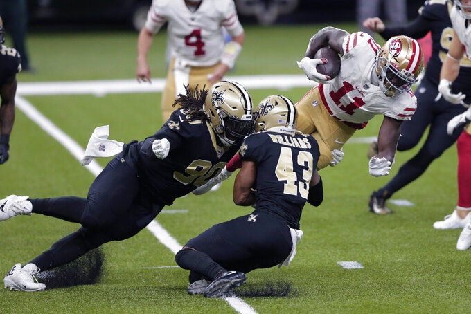 San Francisco 49ers wide receiver Brandon Aiyuk (11) is stopped by New Orleans Saints defensive tackle Malcom Brown (90) and free safety Marcus Williams (43) in the first half of an NFL football game in New Orleans, Sunday, Nov. 15, 2020. (AP Photo/Brett Duke)