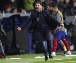 Atletico Madrid's head coach Diego Simone celebrates after Atletico Madrid's Alvaro Morata scoring the opening goal during the Champions League Group D soccer match between Atletico Madrid and Bayer Leverkusen at Wanda Metropolitano stadium in Madrid, Spain, Tuesday, Oct. 22, 2019. (AP Photo/Bernat Armangue)