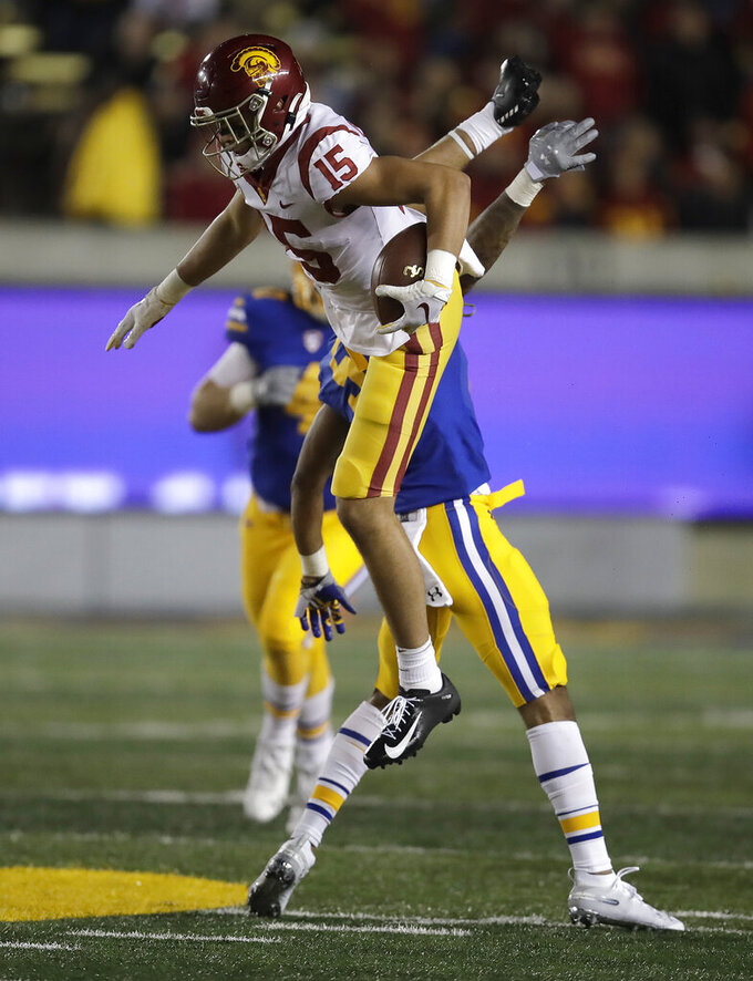 Southern California's Drake London (15) leaps over California's Trey Turner III during the second half of an NCAA college football game Saturday, Nov. 16, 2019, in Berkeley, Calif. (AP Photo/Ben Margot)