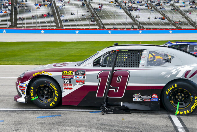 Driver Brandon Jones leaves pit road with a jack stuck to his car during a NASCAR auto race at Texas Motor Speedway, Saturday, March 30, 2019, in Fort Worth, Texas. Jones would complete a lap before returning to his pit box to have the jack removed. (AP Photo/Brandon Wade)
