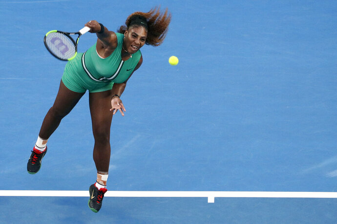 FILE - In this Jan. 21, 2019, file photo, Serena Williams serves to Romania's Simona Halep during their fourth round match at the Australian Open tennis championships in Melbourne, Australia. Serena Williams and Maria Sharapova will finally meet in the U.S. Open, and they'll do it right in their very first match. The past U.S. Open champions, two of the biggest superstars in women's tennis, were sent into an opening-round matchup when the draws were conducted Thursday, Aug. 22, 2019, for the final major of the year. (AP Photo/Mark Schiefelbein, File)