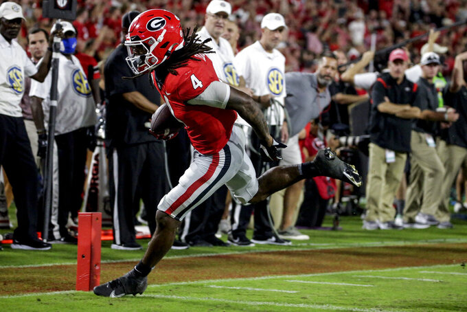 Georgia running back James Cook carries the ball in for a touchdown against South Carolina during the second half of an NCAA college football game Saturday, Sept. 18, 2021, in Athens, Ga. Georgia won 40-13. (AP Photo/Butch Dill)
