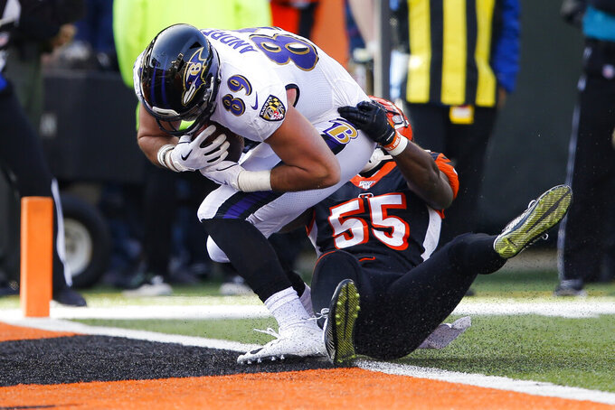 Baltimore Ravens tight end Mark Andrews (89) scores a touchdown against Cincinnati Bengals linebacker LaRoy Reynolds (55) during the first half of NFL football game, Sunday, Nov. 10, 2019, in Cincinnati. (AP Photo/Gary Landers)