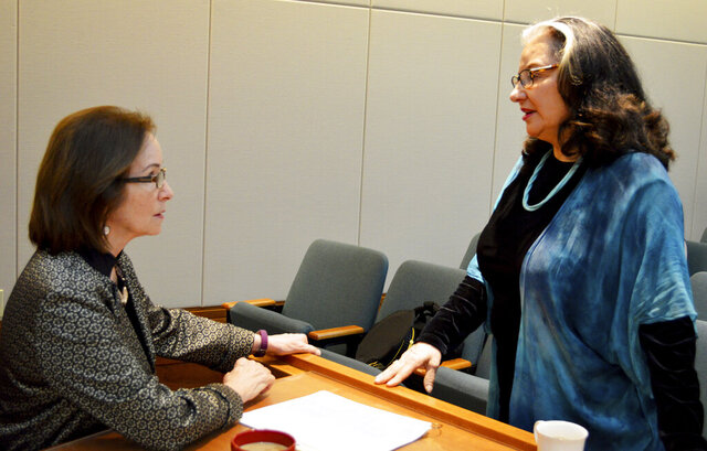 New Mexico Democratic Senate Majority Whip Mimi Stewart, left, and Sen. Antoinette Sedillo Lopez, D-Albuquerque, speak before a committee meeting on Wednesday, Feb. 19, 2020, at the New Mexico Statehouse in Santa Fe, N.M. State lawmakers are racing through the final days of a 30-day Legislative session, which ends Thursday. (AP Photo/Russell Contreras)