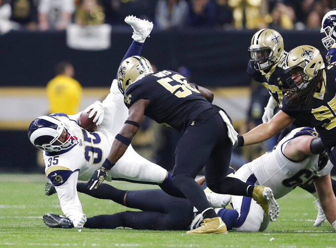 Los Angeles Rams' C.J. Anderson is stopped during the second half of the NFL football NFC championship game against the New Orleans Saints, Sunday, Jan. 20, 2019, in New Orleans. (AP Photo/John Bazemore)