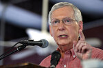 FILE - In this Aug. 3, 2019, file photo, Senate Majority Leader Mitch McConnell, R-Ky., addresses the audience gathered at the Fancy Farm Picnic in Fancy Farm, Ky. Ex-Marine pilot Amy McGrath, who seemed to be gliding toward a primary victory in Kentucky, has come under heavy fire from both directions in the closing days of the Democratic contest to determine who challenges Republican Senate Majority Leader Mitch McConnell in the fall.  (AP Photo/Timothy D. Easley, File)