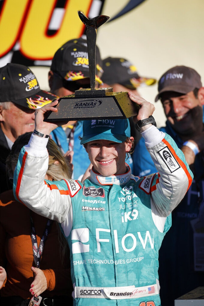 Brandon Jones (19) celebrates after winning a NASCAR Xfinity Series auto race at Kansas Speedway in Kansas City, Kan., Saturday, Oct. 19, 2019. (AP Photo/Colin E. Braley)