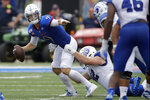 Kansas quarterback Carter Stanley (9) is sacked by Indiana State defensive lineman Henrik Barndt (92) during the second half of an NCAA college football game Saturday, Aug. 31, 2019, in Lawrence, Kan. Kansas won 24-17. (AP Photo/Charlie Riedel)