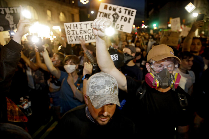 Protesters fill Boulder Ave. after Tulsa Police fired pepper balls at them after President Donald Trump's campaign rally at the BOK Center in Tulsa, Saturday, June 20, 2020.(Mike Simons/Tulsa World via AP)
