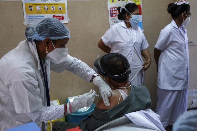 A medical staff receives her second dose of COVID-19 vaccine at a government Hospital in Hyderabad, India, Monday, Feb. 15, 2021. (AP Photo/Mahesh Kumar A.)