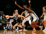 New York Liberty guard Sami Whitcomb (32) dribbles the ball against Seattle Storm defenders Ezi Magbegor (13) and Jewell Loyd (24) during the first half of a WNBA basketball game Friday, Aug. 20, 2021, in New York. (AP Photo/Noah K. Murray)