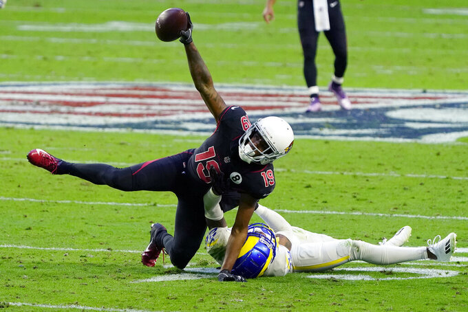 Arizona Cardinals wide receiver KeeSean Johnson (19) falls after making the catch as Los Angeles Rams cornerback Jalen Ramsey defends during the second half of an NFL football game, Sunday, Dec. 6, 2020, in Glendale, Ariz. (AP Photo/Rick Scuteri)