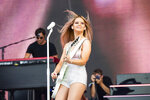 FILE - This June 15, 2019 file photo shows Maren Morris performing at the Bonnaroo Music and Arts Festival in Manchester, Tenn. Morris will perform at this year's CMA Awards in Nashville. The show will air on ABC on Nov. 11. (Photo by Amy Harris/Invision/AP, File)