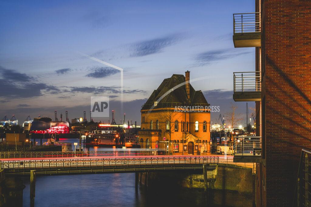 Germany, Hamburg, Water police builidng in Speicherstadt at dusk