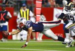 FILE - In this Aug. 26, 2010, file photo, New England Patriots tight end Rob Gronkowski stretches as he dives into the end zone, beating St. Louis Rams cornerback Kevin Dockery, right, for a touchdown in the second quarter during an NFL preseason football game in Foxborough, Mass. With a fun-loving personality as large as his biceps, Gronkowski was chosen 42nd overall in the NFL draft in 2010. He would grow to be a weapon for New England during his nine-year career.  (AP Photo/Charles Krupa, File)