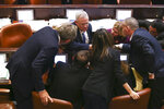 Blue and White party leader Benny Gantz, center, talks during a Knesset session in Jerusalem, Wednesday, Dec. 11, 2019. The Israeli parliament began voting to dissolve itself on Wednesday and pave the path to an unprecedented third election within a year. (AP Photo/Oded Balilty)