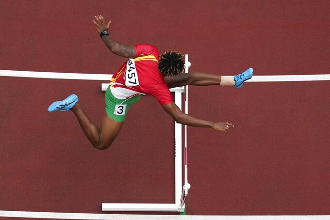 Ned Azemia, of Seychelles, competes during the first round of the men's 400-meter hurdles at the 2020 Summer Olympics, Friday, July 30, 2021, in Tokyo. (AP Photo/Morry Gash)