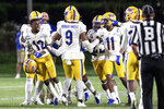 Pittsburg's Paris Ford (12) is restrained by teammates as he shouts at officials after being ejected for targeting during the team's NCAA college football game against Duke in Durham, N.C., Saturday, Oct. 5, 2019. (AP Photo/Ben McKeown)