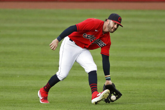Cleveland Indians' Tyler Naquin fields a single hit by Chicago Cubs' Javier Baez (9) in the fifth inning in a baseball game, Wednesday, Aug. 12, 2020, in Cleveland. (AP Photo/Tony Dejak)