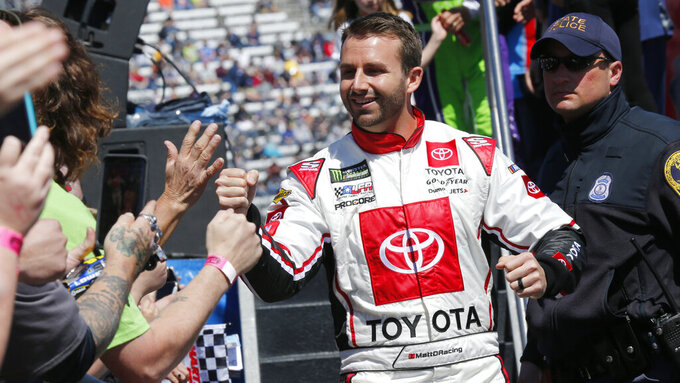 NASCAR Cup Series driver Matt DiBenedetto (95) greets fans during driver introductions prior to the NASCAR Cup Series auto race at the Martinsville Speedway in Martinsville, Va., Sunday, March 24, 2019. (AP Photo/Steve Helber)
