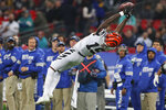 Cincinnati Bengals wide receiver Auden Tate (19) catches a pass against the Los Angeles Rams during the second half of an NFL football game, Sunday, Oct. 27, 2019, at Wembley Stadium in London. (AP Photo/Frank Augstein)