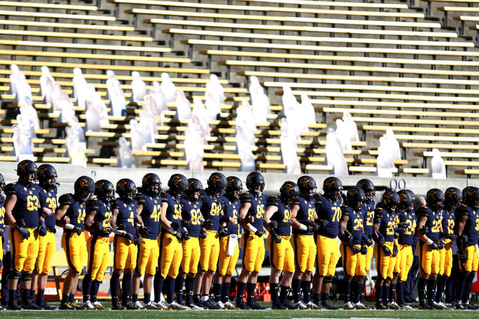 California players stand during a presentation on social justice before the team's NCAA college football game against Stanford on Friday, Nov. 27, 2020, in Berkeley, Calif. (AP Photo/Jed Jacobsohn)