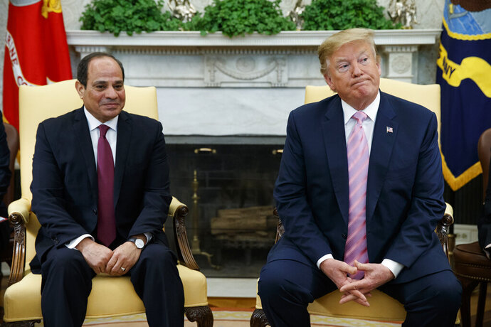 FILE - In this April 9, 2019 file photo, President Donald Trump meets with Egyptian President Abdel Fattah el-Sisi in the Oval Office of the White House in Washington. El-Sissi thanked Trump late Monday, Nov. 4,  for his