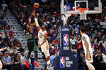 Boston Celtics guard Marcus Smart (36) shoots against New Orleans Pelicans guard E'Twaun Moore (55) in the first half of an NBA basketball game in New Orleans, Sunday, Jan. 26, 2020. (AP Photo/Gerald Herbert)