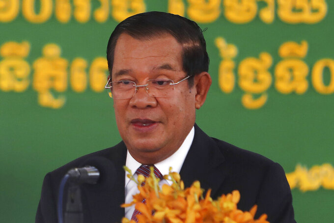 FILE - In this Feb. 7, 2021, file photo, Cambodian Prime Minister Hun Sen delivers a speech during a handover ceremony at Phnom Penh International Airport, in Phnom Penh, Cambodia. Hun Sen boasted Friday, Sept. 17, 2021, of barging uninvited into a video conference call hosted by his political opponents.(AP Photo/Heng Sinith, File)