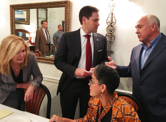U.S. Rep. Marsha Blackburn, left, and U.S. Sen. Marco Rubio, center, speak with participants of a campaign round table after the event Friday, Sept. 14, 2018, in Brentwood, Tenn. (AP Photo/Jonathan Mattise)