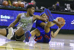 Baylor guard Jared Butler, left, battles Kansas guard Dajuan Harris for a loose ball in the first half of an NCAA college basketball game, Monday, Jan. 18, 2021, in Waco, Texas. (Rod Aydelotte/Waco Tribune-Herald via AP)
