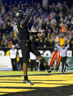 Appalachian State running back Camerun Peoples celebrates after scoring his third touchdown of the first half against Marshall in an NCAA college football game, Thursday, Sept. 2, 2021 at Kidd Brewer Stadium in Boone, N.C. (Walt Unks/The Winston-Salem Journal via AP)
