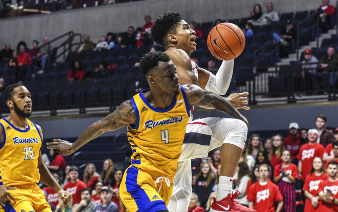 Mississippi guard Breein Tyree (4) is fouled by Cal State Bakersfield guard Taze Moore (4) during an NCAA college basketball game, Saturday, Dec, 7, 2019, in Oxford, Miss. (Bruce Newman/The Oxford Eagle via AP)