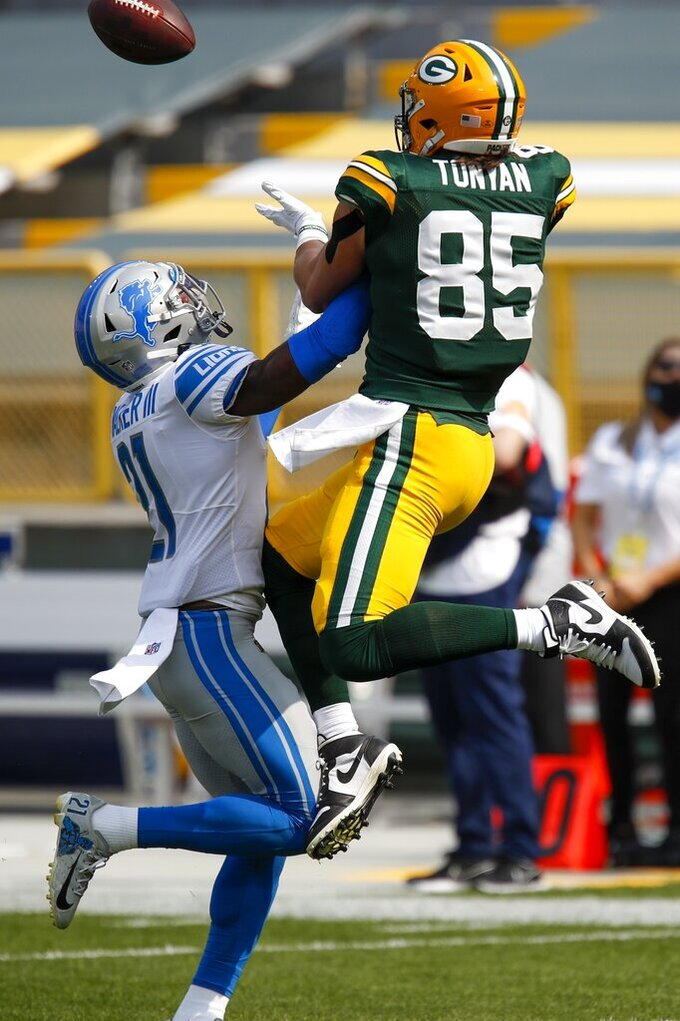 Detroit Lions' Tracy Walker breaks up a pass intended for Green Bay Packers' Robert Tonyan during the first half of an NFL football game Sunday, Sept. 20, 2020, in Green Bay, Wis. (AP Photo/Matt Ludtke)