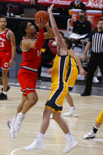 Ohio State's Justice Sueing, left, shoots over Iowa's Joe Wieskamp during the first half of an NCAA college basketball game Sunday, Feb. 28, 2021, in Columbus, Ohio. (AP Photo/Jay LaPrete)