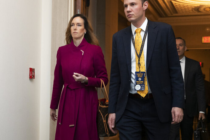 Jennifer Williams, an aide to Vice President Mike Pence, arrives to testify before the House Intelligence Committee on Capitol Hill in Washington, Tuesday, Nov. 19, 2019, during a public impeachment hearing of President Donald Trump's efforts to tie U.S. aid for Ukraine to investigations of his political opponents. (AP Photo/Manuel Balce Ceneta)