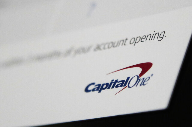 FILE - This  July 22, 2019, file photo, shows Capital One mailing in North Andover, Mass. The U.S. Treasury Department has fined Capital One $80 million for careless network security practices that enabled a hack that accessed the personal information of 106 million of the bank's credit card holders.  (AP Photo/Elise Amendola, File)